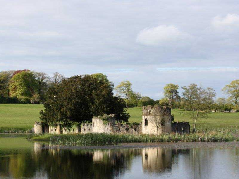 Garden Follies in Ireland : castellated miniature fort on an island within the lake at Larchill Arcadian Gardens, Kilcock - near Dublin