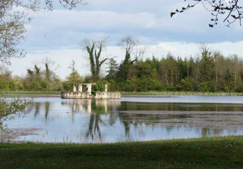 Garden Follies Ireland : The Lake Temple at Larchill Arcadian Garden near Dublin is a circular building on one of the lake islands : possibly intended to emulate the plunge pool baths of ancient Rome