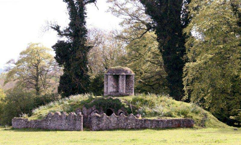 Irish Garden Follies : The Foxes Earth a Grassed Mound with inner chamber reminiscent of an ice house : it is reputed to have been built as a refuge for foxes being pursued by the hunt : Larchill Arcadian Gardens, Kilcock - close to Dublin