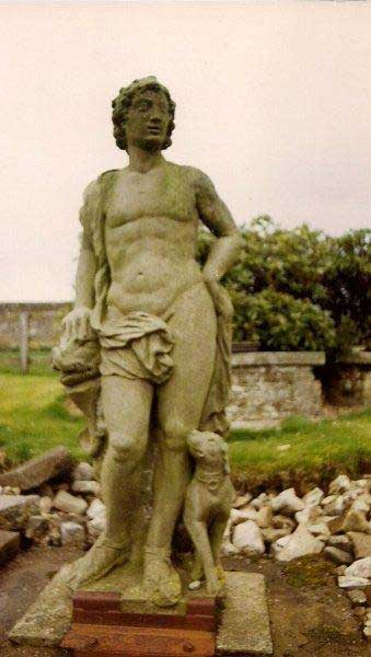 Garden Follies Ireland : the Statue of Meleager now stands at the head of a water feature in the Walled Garden of Larchill Arcadian Gardens near Dublin : originally situated in the middle of the lake it is now protected from the elements